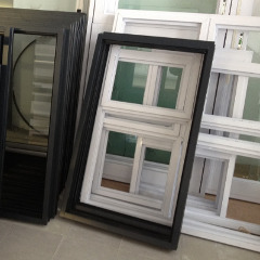 Stacked white and copper aluminium casement window frames